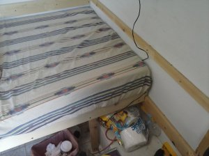 Cut down the mattress and wrap it in a sheet?  voila!  BED!  I cannot begin to tell you how happy I was about this!