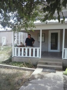 ere I am standing on the porch of the main ranch house